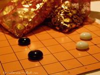 Картонная доска 9х9, подарочные мешочки, камни китайской формы.